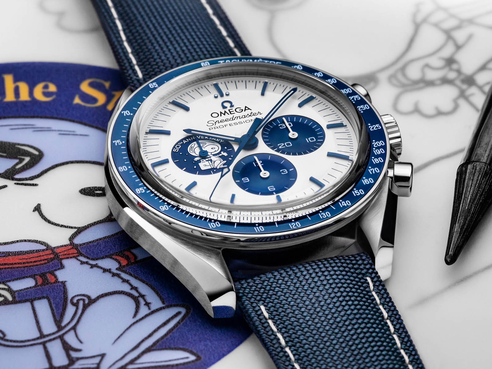 310-32-42-50-02-001-omega-speedmaster-silver-snoopy-award-50th-anniversary-2.jpg